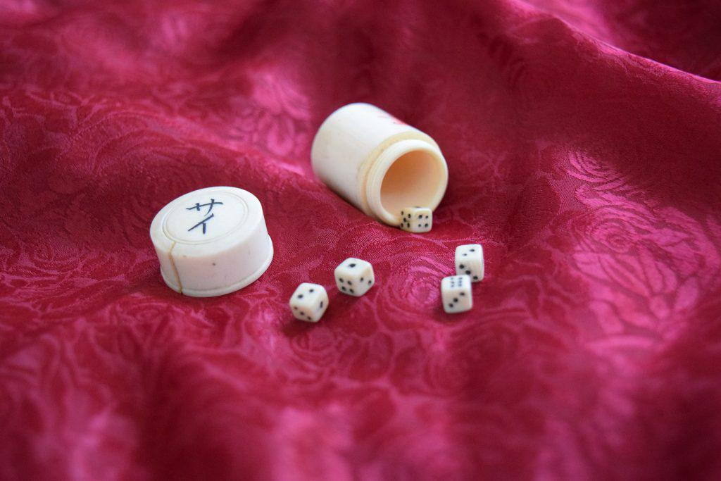 acceptance antique dice red cloth 1024x683 - The 7 pillars of mindfulness - #6 Acceptance